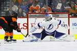 Tampa Bay Lightning's Andrei Vasilevskiy, right, blocks a shot by Philadelphia Flyers' Travis Sanheim during the third period of an NHL hockey game, Saturday, Jan. 11, 2020, in Philadelphia. (AP Photo/Matt Slocum)