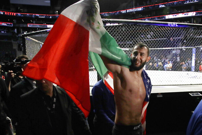 Dominick Reyes celebrates his victory over Chris Weldman in a light heavyweight mixed martial arts bout Friday, Oct. 18, 2019, at UFC Fight Night in Boston. (AP Photo/Elise Amendola)