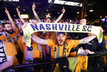 Soccer fans celebrate as the name of Nashville's MLS team, Nashville Soccer Club, is announced during the unveiling of the team name, logo and colors Wednesday, Feb. 20, 2019, in Nashville, Tenn. The expansion franchise is due to start play in 2020. (AP Photo/Mark Humphrey)