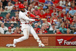 St. Louis Cardinals' Marcell Ozuna hits a ground-rule double to score two runs during the seventh inning of a baseball game against the Washington Nationals, Monday, Sept. 16, 2019, in St. Louis. (AP Photo/Jeff Roberson)