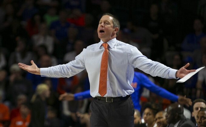 Florida head coach Mike White during the second half of an NCAA college basketball game against Kentucky, Saturday, March 7, 2020, in Gainesville, Fla. (AP Photo/Alan Youngblood)