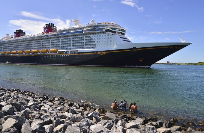 The Disney Dream sails out of Port Canaveral, Fla. on a two night test sailing, also known as a simulation cruise, Saturday, July 17, 2021. The cruise included about 300 Disney cruise employees and their guests. This is the first cruise activity out of Port Canaveral since March of 2020 when cruising was shut down due to COVID-19. (Malcolm Denemark/Florida Today via AP)