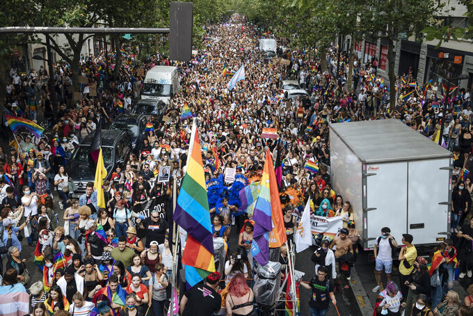 A general view of the annual Gay Pride march in Paris, Saturday, June 26, 2021. This year's march in Paris comes amid widespread fury and concern in Europe about legislation in EU-member nation Hungary that will ban showing content about LGBT issues to children. (AP Photo/Lewis Joly)
