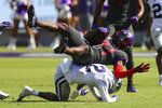 TCU running back Daimarqua Foster (21) is brought down by Kansas State defensive back AJ Parker (12) in the first quarter of an NCAA college football game Saturday, Oct. 10, 2020, in Arlington, Texas. (AP Photo/Richard W. Rodriguez)