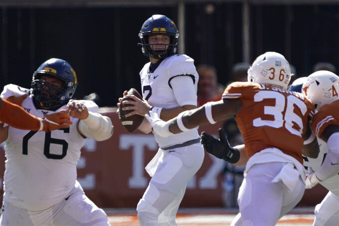 West Virginia quarterback Jarret Doege (2) looks to pass against Texas during the first half of an NCAA college football game in Austin, Texas, Saturday, Nov. 7, 2020. (AP Photo/Chuck Burton)