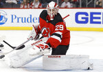 FILE- In this Feb. 20, 2020, file photo, New Jersey Devils goaltender Mackenzie Blackwood (29) covers the net during the first period of an NHL hockey game in Newark, N.J. The Devils have resigned restricted free agent goaltender goaltender Mackenzie Blackwood to a three-year contract, the team announced Wednesday, Dec. 23, 2020. (AP Photo/Kathy Willens, File)