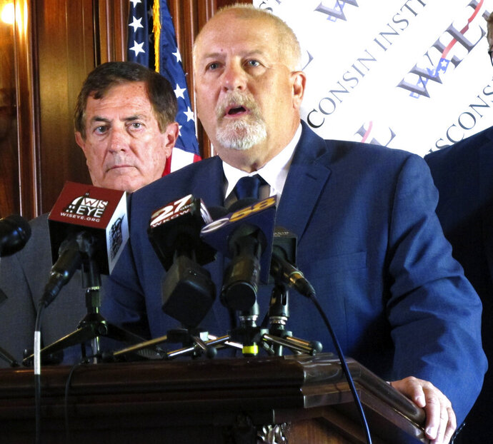 Conservative attorney Rick Esenberg details a new lawsuit asking the Wisconsin Supreme Court to overturn four partial vetoes made by Democratic Gov. Tony Evers and limit the ability of future governors to make similar vetoes during a news conference at the Statehouse in Madison, Wis., Wednesday, July 31, 2019. If successful, the move would reverse more than four decades of precedent. (AP Photo/Scott Bauer)