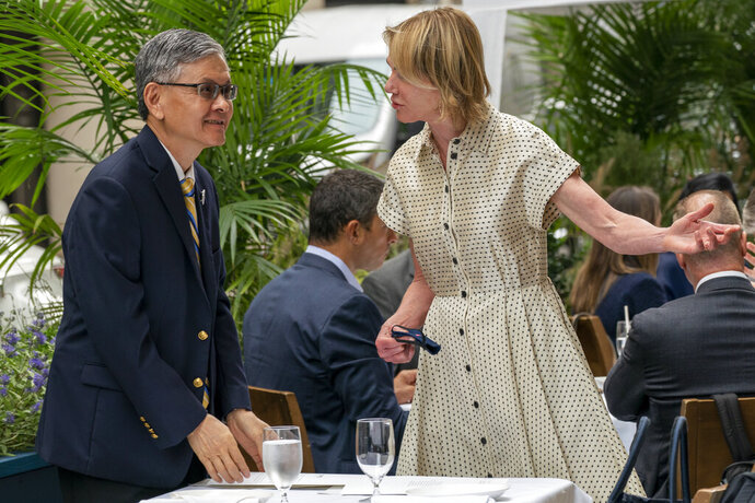 U.S. Ambassador to the United Nations Kelly Craft, right, meets James K.J. Lee, director-general of the Taipei Economic and Cultural Office in New York, for lunch at a restaurant in Midtown Manhattan, Wednesday, Sept. 16, 2020. (AP Photo/Mary Altaffer)