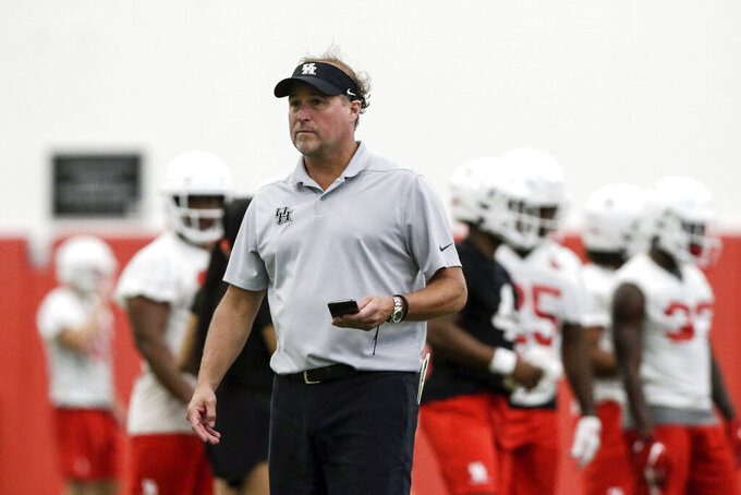 Houston NCAA college football head coach Dana Holgorsen looks on during the first day of fall football practice in Houston, Texas, Saturday, Aug. 3, 2019. Holgorsen debuts as Houston's coach against Oklahoma on Sunday. (Tim Warner/Houston Chronicle via AP)