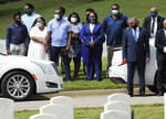 HFM*Relatives of Army veteran Damian Daniels and others watch from a distance as his casket is lowered into the ground at Alabama National Cemetery in Montevallo, Ala., on Friday, Sept. 11, 2020. Daniels, an Alabama native who served in Afghanistan, was fatally shot by a sheriff's deputy at his home in San Antonio, Texas, last month. Relatives say he was troubled mentally. (AP Photo/Jay Reeves)