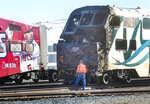Investigators work at the scene after an RV was hit by a commuter train and burst into flames along a track in Santa Fe Springs, Calif., Friday, Nov. 22, 2019. Authorities say the collision occurred shortly after 5:30 a.m. Friday at an intersection in an industrial area of Santa Fe Springs. There were no immediate reports of injuries. All passengers on the Metrolink train were safely evacuated. (Mark Rightmire/The Orange County Register via AP)