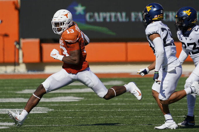 Texas' Brennan Eagles (13) runs after a catch against West Virginia during the second half of an NCAA college football game in Austin, Texas, Saturday, Nov. 7, 2020. (AP Photo/Chuck Burton)