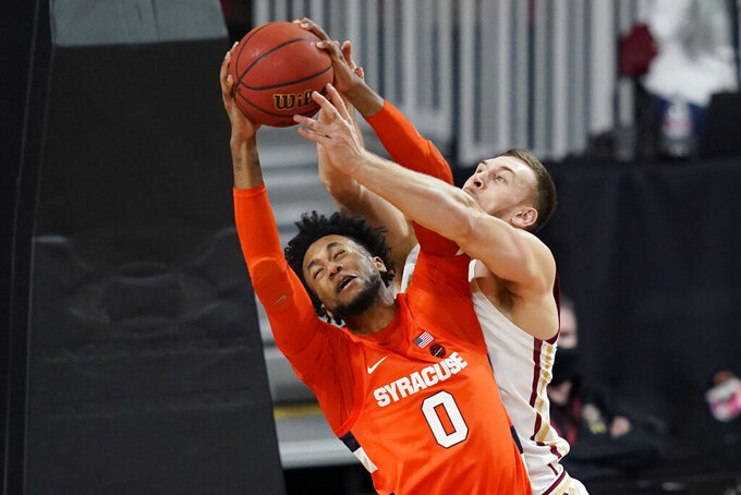 Syracuse forward Alan Griffin (0) and Boston College forward James Karnik, right, battle for a rebound during the second half of an NCAA college basketball game, Saturday, Dec. 12, 2020, in Boston. Syracuse won 101-63. (AP Photo/Elise Amendola)