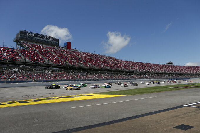 Ty Gibbs (18) leads the pack to start the General Tire 200 ARCA Series auto race at Talladega Superspeedway Saturday, April 24, 2021 in Talladega, Ala. (AP Photo/Butch Dill)