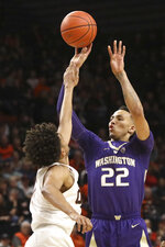Washington's Dominic Green, right, shoots past Oregon State's Stephen Thompson Jr.'s defense during the first half of an NCAA college basketball game in Corvallis, Ore., Saturday, Jan. 26, 2019. (AP Photo/Amanda Loman)