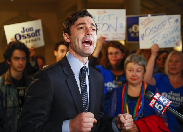 FILE - In this Wednesday, March 4, 2020, file photo, Jon Ossoff speaks to the the media and supporters after he qualified to run in the Senate race against Republican Sen. David Perdue in Atlanta. Two McConnell-allied groups are preparing to spend $22 million to help GOP Sen. David Perdue against Democrat Ossoff in Georgia, where Republican advantages among suburban voters have eroded.  (Bob Andres/Atlanta Journal-Constitution via AP, File)
