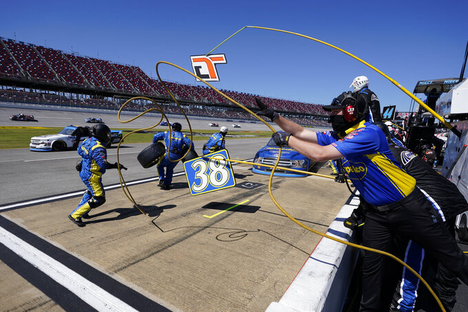 Driver Todd Gilliland (38) pulls into his pit stall for tires and fuel during the NASCAR Truck series auto race at Talladega Superspeedway, Saturday, Oct. 3, 2020, in Talladega, Ala.. (AP Photo/John Bazemore)
