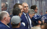 St. Louis Blues interim head coach Craig Berube, center, watches from the bench during the second period in Game 4 of an NHL first-round hockey playoff series against the Winnipeg Jets, Tuesday, April 16, 2019, in St. Louis. (AP Photo/Jeff Roberson)