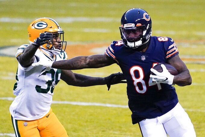 Chicago Bears' Cordarrelle Patterson tries to get past Green Bay Packers' Chandon Sullivan during the first half of an NFL football game Sunday, Jan. 3, 2021, in Chicago. (AP Photo/Nam Y. Huh)