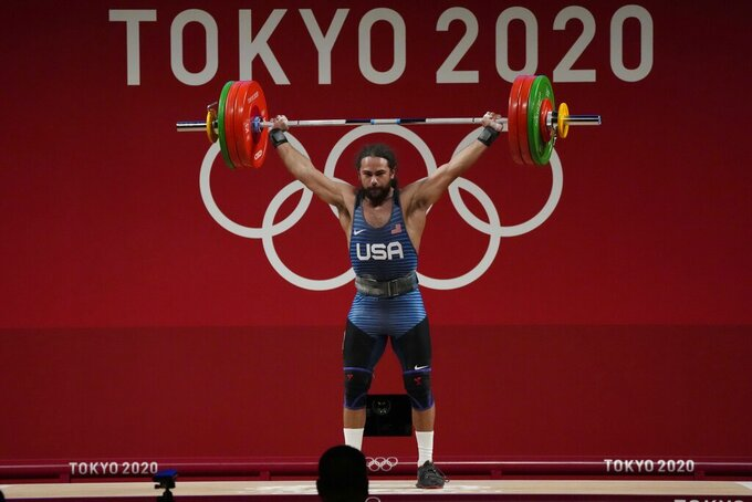 Harrison James Maurus of the United States competes in the men's 81kg weightlifting event, at the 2020 Summer Olympics, Saturday, July 31, 2021, in Tokyo, Japan. (AP Photo/Luca Bruno)