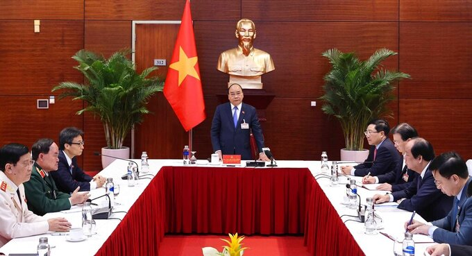 Vietnam's Prime Minister Nguyen Xuan Phuc speaks during an urgent meeting on COVID-19 in Hanoi, Vietnam, Thursday Jan. 28, 2021. Vietnam has reported more than 80 new cases of local transmission after nearly two months. (Hoang Thong Nhat/VNA via AP)