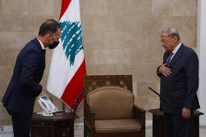 In this photo released by Lebanon's official government photographer Dalati Nohra, Lebanese president Michel Aoun, right, meets with German Foreign Minister Heiko Maas, at the Presidential Palace in Baabda, east of Beirut, Lebanon, Wednesday, Aug. 12, 2020. Maas said that Lebanon needs a