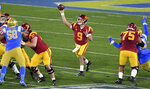 Quarterback Kedon Slovis #9 of the USC Trojans passes against the UCLA Bruins in the first half of a NCAA Football game at the Rose Bowl in Pasadena on Saturday, December 12, 2020. (Keith Birmingham/The Orange County Register via AP)