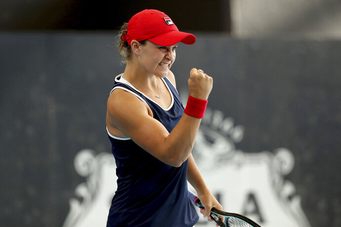 Australian Ashleigh Barty celebrates her win over Ukrainian Dayana Yastremska during their Adelaide International tennis match in Adelaide, Saturday, Jan. 18, 2020. (AP Photo/James Elsby)