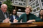 Democratic presidential candidate U.S. Sen. Elizabeth Warren, D-Mass., files to have her name listed on the New Hampshire primary ballot, Wednesday, Nov. 13, 2019, in Concord, N.H. At left is New Hampshire Secretary of State Bill Gardner. (AP Photo/Charles Krupa)