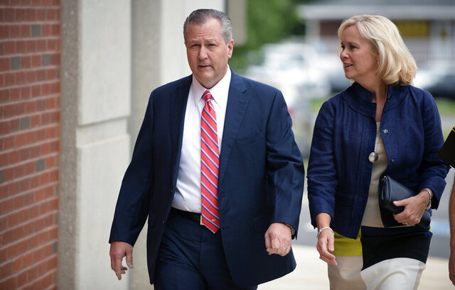 FILE - In this Friday, Sept. 2, 2016 file photo, Mike Hubbard, former Alabama Speaker of the House, and his wife, Susan, arrive for a post trial hearing at the Lee County Justice Center in Opelika, Ala..  Mike Hubbard reported Friday, Sept. 11, 2020 to a county detention center to begin the sentence after an  unsuccessful effort to overturn his conviction. (Albert Cesare/The Montgomery Advertiser via AP, Pool)