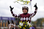 Joel Rosario celebrates after riding Jaywalk to victory in the Breeders' Cup Juvenile Fillies horse race at Churchill Downs, Friday, Nov. 2, 2018, in Louisville, Ky. (AP Photo/Darron Cummings)