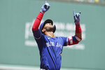 Toronto Blue Jays' Lourdes Gurriel Jr., celebrates his home run as he arrives at home plate in the first inning of a baseball game against the Boston Red Sox, Sunday, June 13, 2021, in Boston. (AP Photo/Steven Senne)