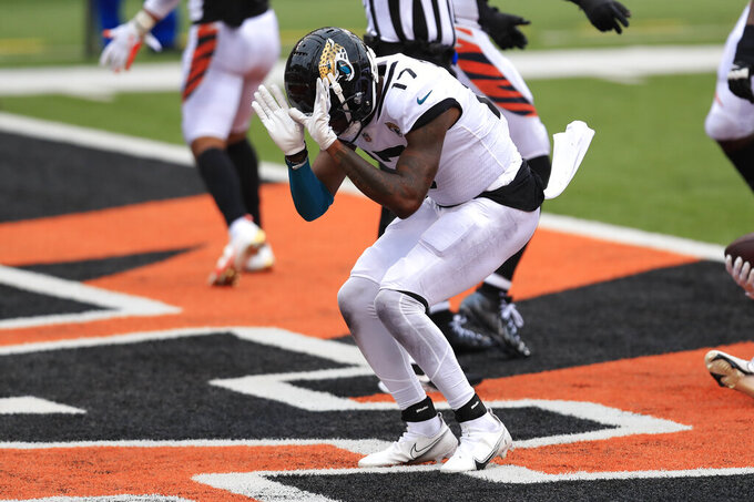 Jacksonville Jaguars wide receiver D.J. Chark (17) celebrates a touchdown against the Cincinnati Bengals in the second half of an NFL football game in Cincinnati, Sunday, Oct. 4, 2020. (AP Photo/Aaron Doster)