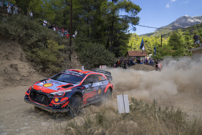 Danis Sordo and his co driver Borha Rozada of Spain with their Hyundai i20 coupe WRC car compete in the WRC Acropolis Rally at the stage of Aghii Theodori, west of Athens, on Friday, Sept. 10, 2021. The World Rally Championship returned to Greece after an eight-year absence. (AP Photo/Petros Giannakouris)