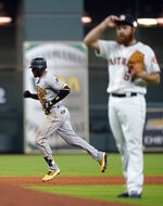 Pittsburgh Pirates' Starling Marte (6) runs the bases after hitting a home run off Houston Astros pitcher Cy Sneed, right, during the fifth inning of a baseball game Thursday, June 27, 2019, in Houston. (AP Photo/David J. Phillip)