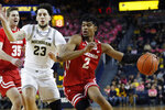 Wisconsin forward Aleem Ford (2) drives against Michigan forward Brandon Johns Jr. (23) during the first half of an NCAA college basketball game, Thursday, Feb. 27, 2020, in Ann Arbor, Mich. (AP Photo/Carlos Osorio)