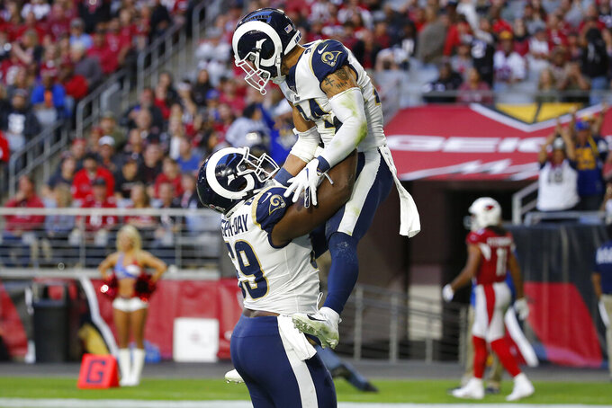 Los Angeles Rams safety Taylor Rapp (24) celebrates his interception against the Arizona Cardinals in for a touchdown with Los Angeles Rams defensive tackle Sebastian Joseph-Day during the second half of an NFL football game, Sunday, Dec. 1, 2019, in Glendale, Ariz. (AP Photo/Rick Scuteri)
