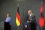 German Chancellor Angela Merkel, left, listens the Albanian Prime Minister Edi Rama during a news conference a in Tirana, Albania, Tuesday, Sept. 14, 2021. Merkel is on a farewell tour of the Western Balkans, as she announced in 2018 that she wouldn't seek a fifth term as Germany's Chancellor. (AP Photo/Franc Zhurda)