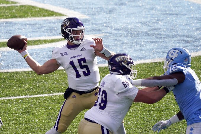 Western Carolina quarterback Will Jones (15) passes against North Carolina during the first half of an NCAA college football game in Chapel Hill, N.C., Saturday, Dec. 5, 2020. (AP Photo/Gerry Broome)
