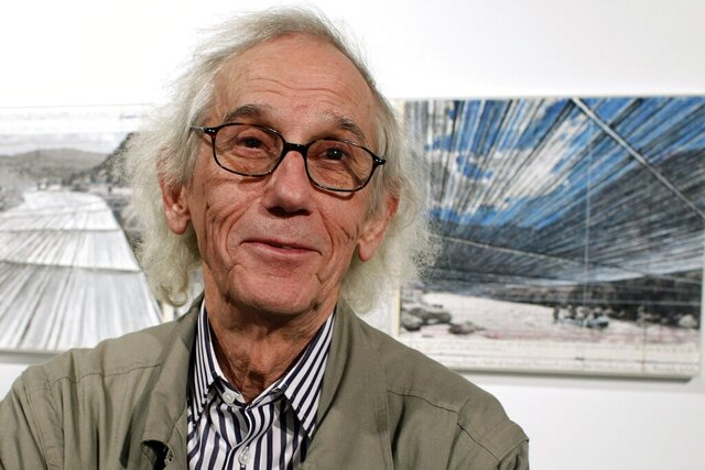 FILE - This Jan. 23, 2013 file photo shows artist Christo posing in front of his proposed
