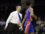 Florida coach Mike White talks to guard Jalen Hudson (3) during the second half of an NCAA college basketball game against Vanderbilt on Wednesday, Feb. 27, 2019, in Nashville, Tenn. Florida won 71-55. (AP Photo/Mark Humphrey)