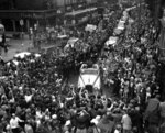 FILE - In this Tuesday, July 11, 1961 file photo, Russian cosmonaut Major Yuri Gagarin, standing in an open car, waves to crowds of spectators as he drives into London from the London airport. The successful one-orbit flight on April 12, 1961 made the 27-year-old Gagarin a national hero and cemented Soviet supremacy in space until the United States put a man on the moon more than eight years later. (AP Photo/File)