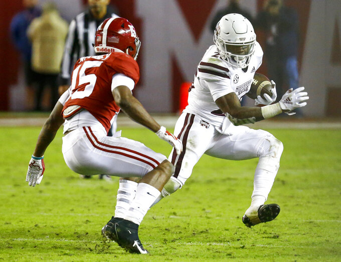 Mississippi State wide receiver Deddrick Thomas (2) tries to get around Alabama defensive back Xavier McKinney (15) as he carries the ball during the second half of an NCAA college football game, Saturday, Nov. 10, 2018, in Tuscaloosa, Ala. (AP Photo/Butch Dill)
