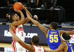 Ohio State guard Eugene Brown, left, goes up for a shot against Morehead State guard Ta'lon Cooper (55)   during the first half of an NCAA college basketball game in Columbus, Ohio, Wednesday, Dec. 2, 2020. (AP Photo/Paul Vernon)