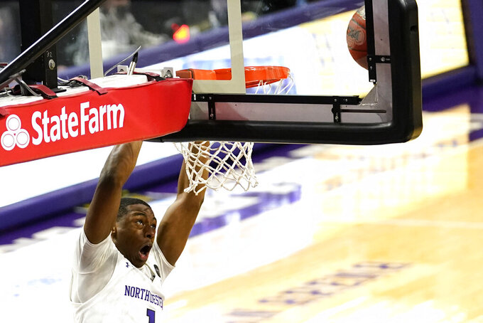 Northwestern guard Chase Audige reacts as he misses a dunk during the second half of an NCAA college basketball game against Rutgers in Evanston, Ill., Sunday, Jan. 31, 2021. (AP Photo/Nam Y. Huh)
