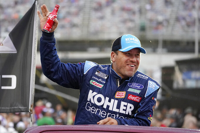 Ryan Newman waves to fans before a NASCAR Cup Series auto race at Bristol Motor Speedway Saturday, Sept. 18, 2021, in Bristol, Tenn. (AP Photo/Mark Humphrey)