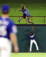 Texas Rangers center fielder Delino DeShields looks up at a home run by Tampa Bay Rays' Austin Meadows during the eighth inning of a baseball game Tuesday, Sept. 10, 2019, in Arlington, Texas. (AP Photo/Richard W. Rodriguez)