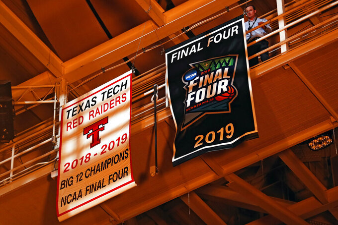 Texas Tech's Big 12 championship and Final Four banners are unveiled before an NCAA college basketball game Tuesday, Nov. 5, 2019, in Lubbock, Texas. (AP Photo/Brad Tollefson)
