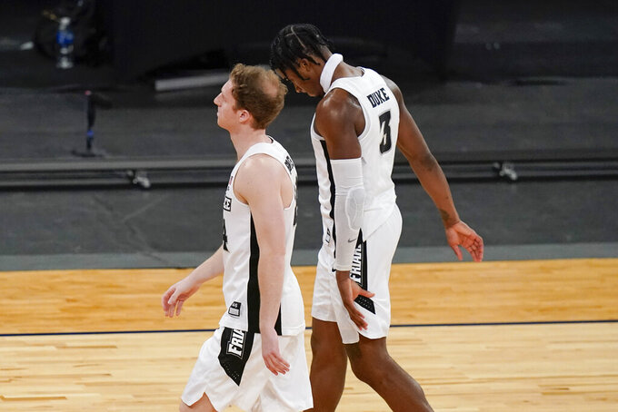 Providence's David Duke (3) leaves the court with a teammates after an NCAA college basketball game against DePaul in the Big East conference tournament Wednesday, March 10, 2021, in New York. DePaul won 70-62. (AP Photo/Frank Franklin II)