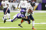 Chicago Bears wide receiver Javon Wims, right, tries to break a tackle by Minnesota Vikings cornerback Mackensie Alexander, left, after catching a pass during the first half of an NFL football game, Sunday, Dec. 29, 2019, in Minneapolis. (AP Photo/Andy Clayton-King)